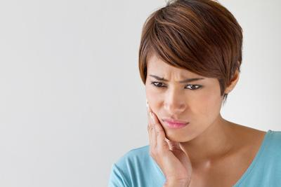 Woman in pain | Affordable Dental Center of Wellington