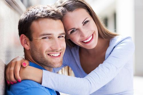 Young male and female couple hugging | Dentist Royal Palm Beach FL