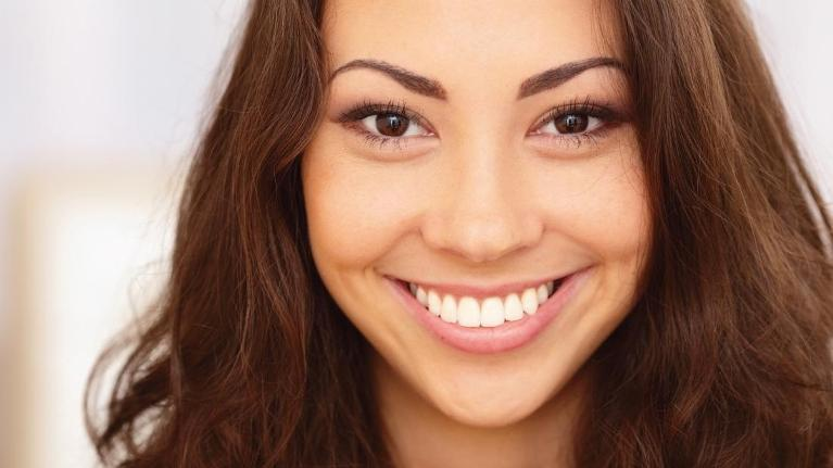 Woman Smiling | Affordable Dental Center of Wellington